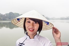 Portrait of beautiful girl with asian conical hat, Hanoi, Vietnam
