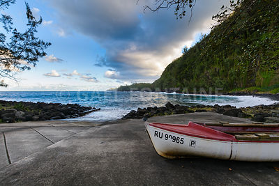 Boats and coast at Anse des Cascades near Sainte Rose city, Reunion Island