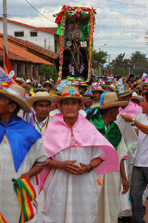 Elderly man accompanying figure of San Ignacio during main procession of festival, San Ignacio de Moxos, Bolivia