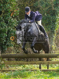 Gaby Cooke jumping a hunt jump on Bruce's Lane