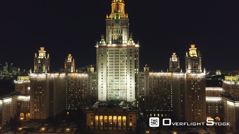 Moscow State University and Illuminated Moscow Skyline at Winter Night. Russia. Aerial View. Drone is Flying Upward and Backward Revealing Cityscape. Establishing Shot.