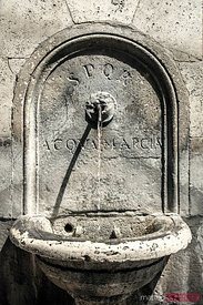 Old stone fountain in Rome, Italy