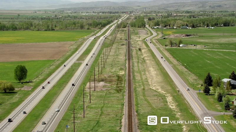 Interstate 90 sits next to a main railroad line near Bozeman, Montana