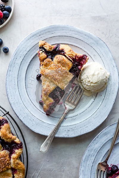 Slice of Berry Pie on a ceramic plate