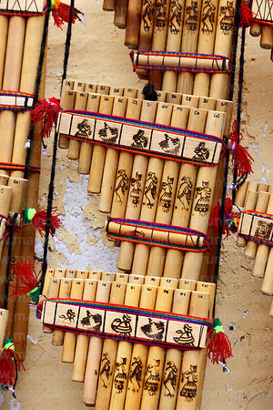 Close up of panpipes for sale in market showing notes of each pipe, Cusco, Peru