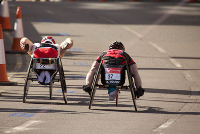 Joshua Cassidy (20th) of Canada (no22) and  Tomasz Hamerlak (16th) of Poland (no37) Racing in The 2014 Virgin London Marathon