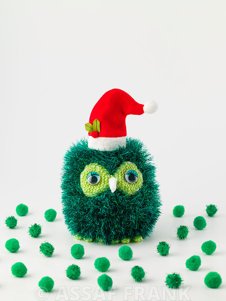 Christmas pom poms on white background