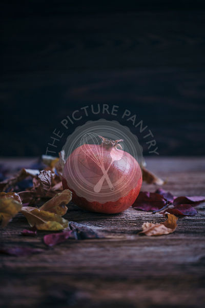 Pomegranate on a rustic wooden table