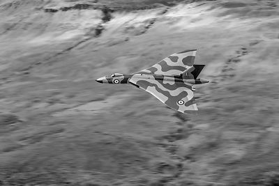 Vulcan low-level against hillside B&W version
