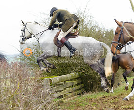 Andrew Collie jumps a hedge away from the meet at Ladywood Lodge
