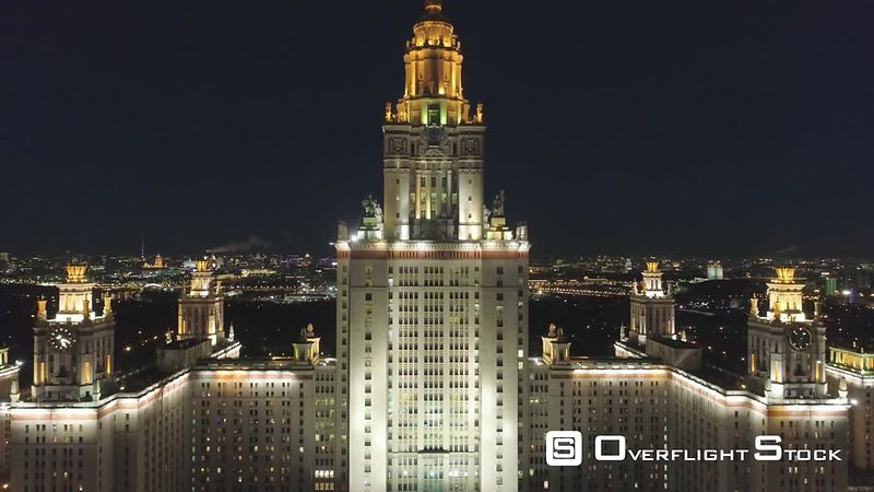 Moscow State University Main Campus and Illuminated Moscow Cityscape at Clear Winter Night. Russia. Aerial View. Drone is Flying Upward. Establishing Shot.