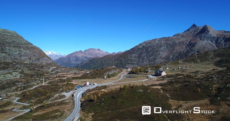 MountaTown, 4k Aerial Backward View of a Alpine Village, on the Top of Simplon Pass, Sunny Autumn Evening, Ticino, Alps of Switzerland