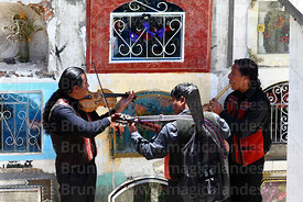 Musicians playing for souls of the deceased in cemetery during Todos Santos festival, La Paz, Bolivia