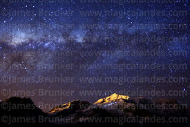 Milky Way Galactic Centre above Mt Huayna Potosí, lights of climbers on the glacier, Cordillera Real, Bolivia