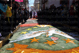 Main procession of the Virgen de la Candelaria over dyed sawdust street art, Puno, Peru
