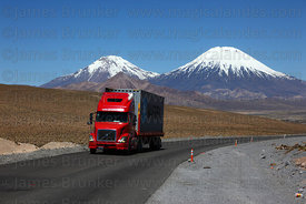 Truck on Highway 11, Payachatas volcanos in background , Lauca National Park , Region XV , Chile