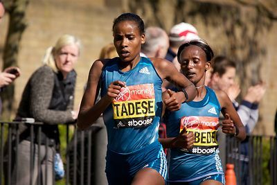 Feyse Tadese (4th) and Aberu Kebede (5th) of Ethiopia Running at The 2014 Virgin London Marathon