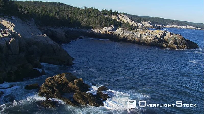 Flying along rocky coastline of Maine