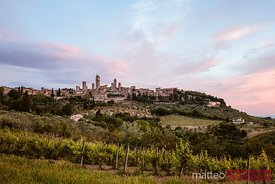 Sunrise over San Gimignano and vineyards, Tuscany, Italy