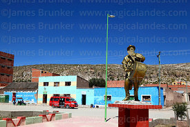 Statue of local sicureada musician in village square, Curahuara de Carangas, Oruro Department, Bolivia