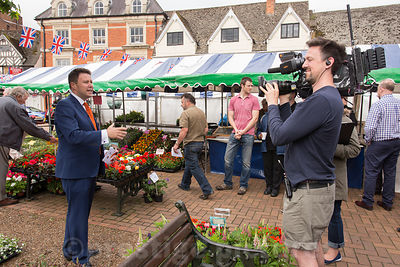 BBC presenter Jon Kay broadcasting live from Banbury Market