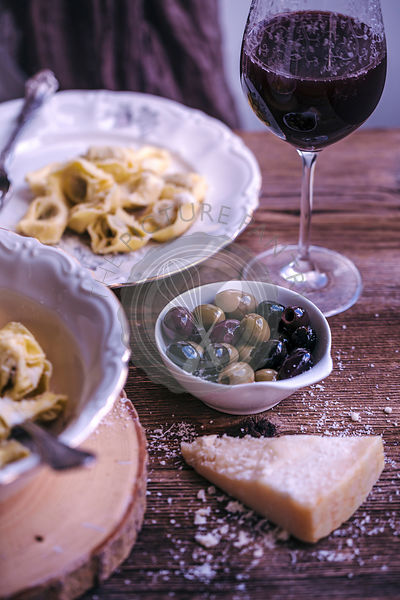 Olives served with tortelloni pasta for lunch