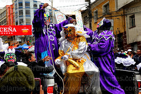 "Pepinos control the pepino who is due to be ""buried""  during parades for the Entierro del Pepino, La Paz, Bolivia"