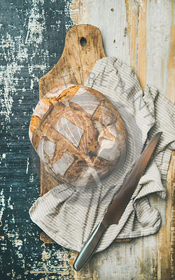 Flat-lay of sourdough wheat bread over linen napkin