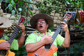 Man playing guitar and singing during carnival, Canasmoro, Tarija Department, Bolivia