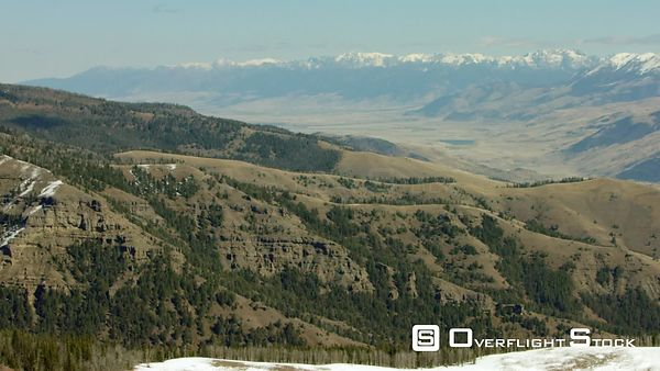 Snow-covered peaks of the Absaroka mountain range tower over the Paradise Valley and Tom Miner basin near Yellowstone National Park