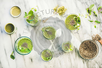 Matcha green vegan smoothie with chia seeds, top view