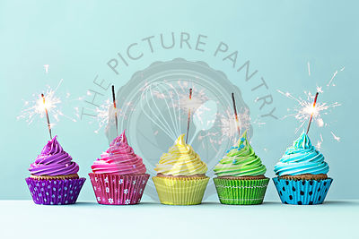 Colorful cupcakes with sparklers