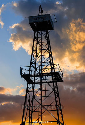Oil Derrick and clouds at sunset