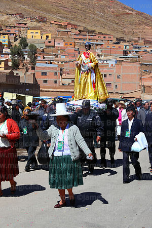 Quechua lady carries incense burner in front of San Bartolome during procession at start of Chutillos festival, Potosí, Bolivia