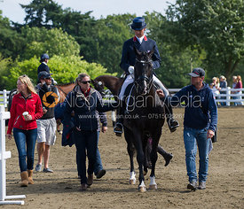 Olympic Gold medallist Charlotte Dujardin helps team-mate Carl Hester during the National Championships, 15/9/12