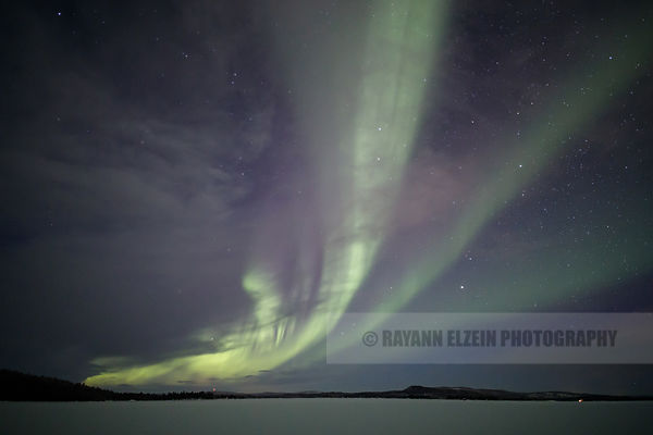 The Northern Lights are visible between the clouds on Ukonjärvi