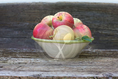 apples, red, green, fruit, autumn, rustic bench, white background, outdoors, in hand painted ceramic bowl,  juicy, fresh, healthy eating,