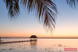 Pier and hut at sunset, Laguna Bacalar, Mexico