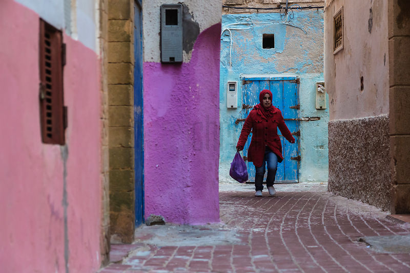 Girl in Red Coat in Narrow Alley