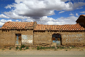 Vote for MAS graffiti on doors of adobe / mud brick houses in Belén village, Potosí Department, Bolivia