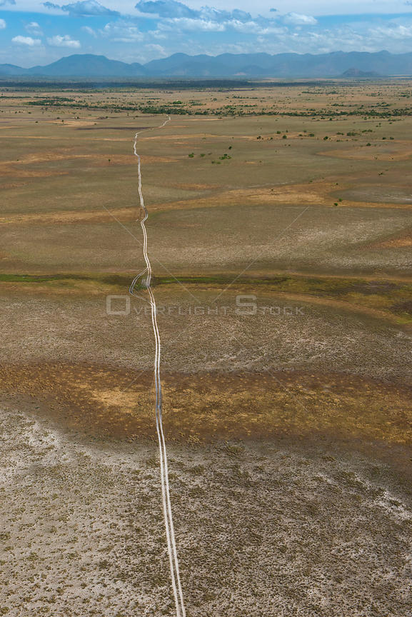 Aerial view of dirt road crossing the Rurununi savanna, Guyana, South America