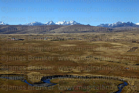 View across altiplano to Warawarani group of peaks, Cordillera Real, Bolivia