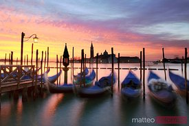 Row of gondolas at sunrise, Venice, Italy