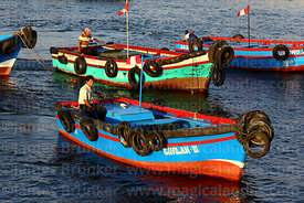 Small fishing boats in port, Ilo, Peru