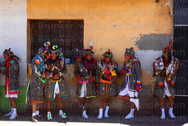 Kusillos take a break from dancing in the shade at Virgen de la Candelaria festival, Puno, Peru