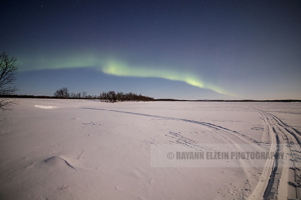 Northern lights low above the northern horizon