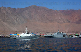 Chilean Navy Protector Class General Service Launch # LSG-1624  (L) and Maritime Zone Patrol Boat moored off desert coast near Iquique , Region I , Chile