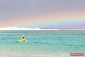 Man kayaking in the lagoon of Rarotonga, Cook Islands