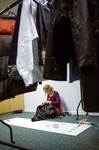 Crisis-Christmas-lone-volunteer-sitting-on-floor-sewing-clothes-copyright-Rob-Johns-14706-19-BJ