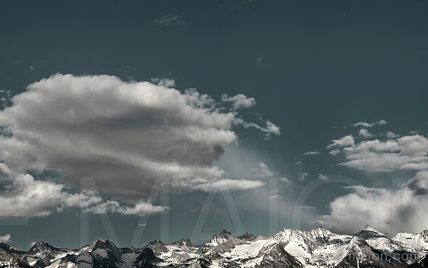 Mountain range below blue sky